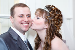 Bride kissing groom in cheek Stock Photo