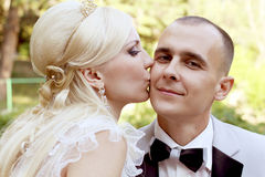 Bride kissing groom with love Stock Photography