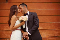 Bride kissing her groom Royalty Free Stock Images