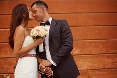 Bride kissing her groom Stock Photo