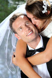 Bride kissing her groom Royalty Free Stock Photo