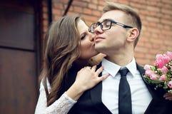 The bride kissing husband Stock Photos
