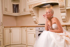 Bride in the kitchen Stock Photography
