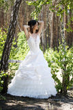 Bride lacing white shoes Stock Images