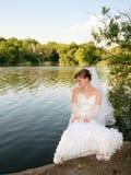 Bride at the lake Stock Photo