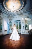 Bride in a big beautiful room with a chandelier Royalty Free Stock Photos