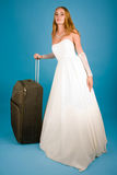 Bride with large suitcase Stock Photography