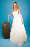Bride with large suitcase Stock Images
