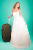 Bride with large suitcase Royalty Free Stock Photos