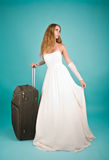 Bride with large suitcase Royalty Free Stock Photo