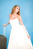 Bride with large suitcase Royalty Free Stock Images