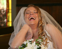 Bride laughing in church Stock Photos