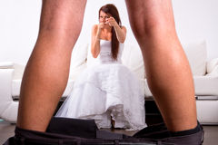 Bride laughing from the groom striptease. At home Royalty Free Stock Photography
