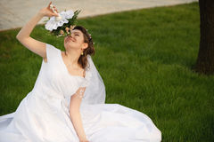 The bride on a lawn Royalty Free Stock Photos