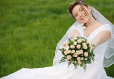 The bride on a lawn Royalty Free Stock Image
