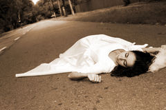 Bride laying at road Royalty Free Stock Photos