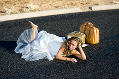 Bride laying in street Stock Photos