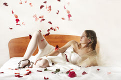 Bride lays on a bed. Stock Photo