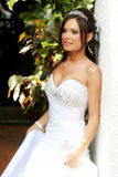 Bride leaning against a wall Royalty Free Stock Image