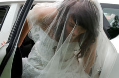 Bride leaving car Royalty Free Stock Photo