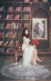 Bride in library chair Stock Images