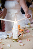 Bride lighting candle Royalty Free Stock Photography