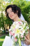 Bride with lily flowers Stock Photography