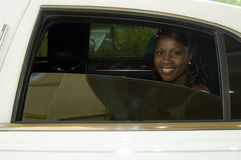 Bride in Limousine. A smiling african american bride in a limousine stock photography