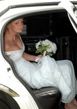 Bride in Limousine. A beautiful bride in a limousine Royalty Free Stock Image