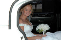 Bride in Limousine. A beautiful bride smiling in a limousine Royalty Free Stock Photography