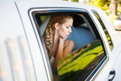 Bride in limousine Stock Photos