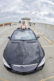 Bride in Limousine sunroof. A smiling bride standing out of sunroof in a limousine Royalty Free Stock Photos