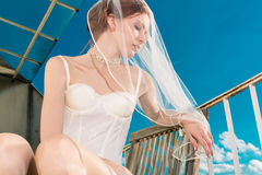Bride in lingerie for her wedding dreaming Stock Image