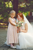 Bride and little sister Royalty Free Stock Images