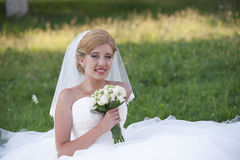 Bride with white bouquet of flowers Stock Photos