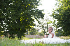 Bride with white bouquet of flowers Royalty Free Stock Photos