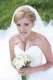 Bride with white bouquet of flowers Royalty Free Stock Photography