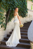 The bride in a long dress on the stairs stock photos