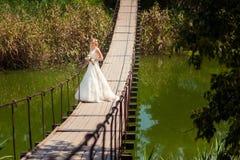 Bride on long suspension bridge Royalty Free Stock Photos