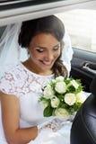 Bride looking at bouquet Stock Photos