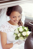 Bride looking at bouquet, tinted Stock Image