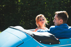 Bride Looking at Groom in Car. Bride looking at groom in cabriolet Stock Photography