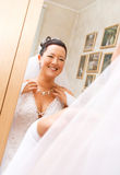 Bride looking at her reflection Royalty Free Stock Photos