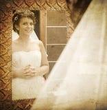 Bride looking into mirror royalty free stock image