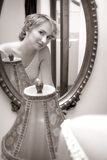 Bride looking in a mirror Royalty Free Stock Photography