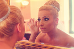 Bride looking in the mirror Royalty Free Stock Photography