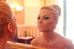 Bride looking in the mirror Stock Image