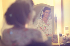 Bride looking in the mirror Royalty Free Stock Photos