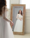 Bride looking in a mirror Stock Photography
