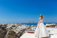 Bride  looking out to the sea Stock Images